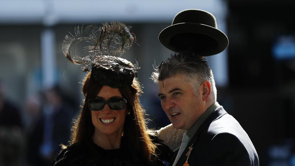 Racegoers arrive ahead of Ladies Day. Large amounts of money are gambled during Cheltenham Festival week, with hundreds of millions of pounds being bet over the week.   (Stefan Wermuth  / REUTERS)