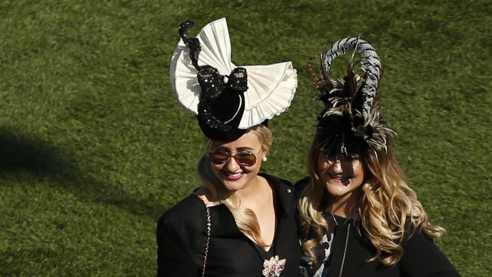 Racegoers arrive ahead of Ladies Day at Cheltenham Racecourse.  The Cheltenham Festival originated in 1860 when the National Hunt Chase was first held at Market Harborough.  (Andrew Boyers / REUTERS)