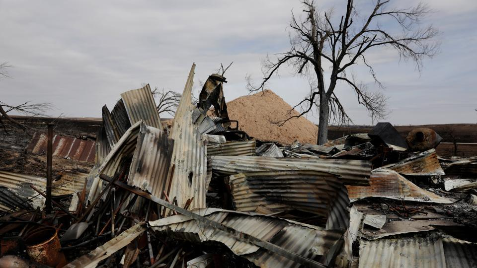 A fire extinguisher lies on the ground inside the remains of an equipment shed burned by wildfires near Lipscomb, Texas, U.S. (Lucas Jackson  / REUTERS)