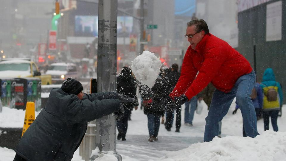 A man and child take part in a snowball fight in Times Square during a snowstorm, New York, U.S. (Carlo Allegri/REUTERS)