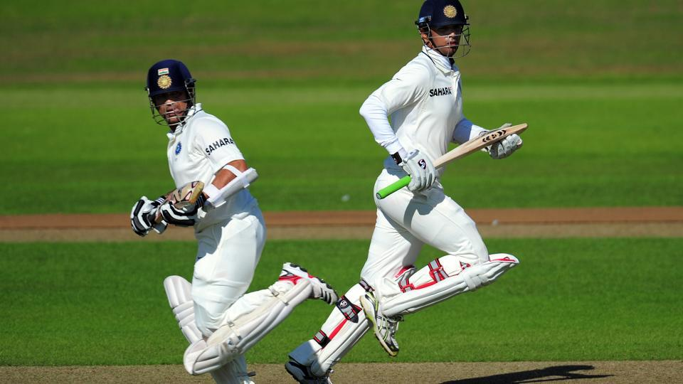 Sachin Tendulkar (left) and Rahul Dravid run between the wickets during a tour match between Somerset and India in Taunton on July 16, 2011.