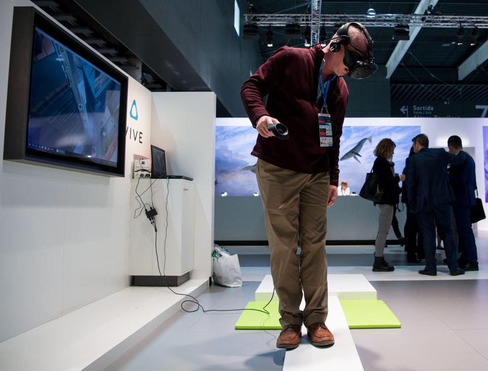 A visitor uses a virtual reality device during the Mobile World Congress on the third day of the MWC in Barcelona, on March 1, 2017.
