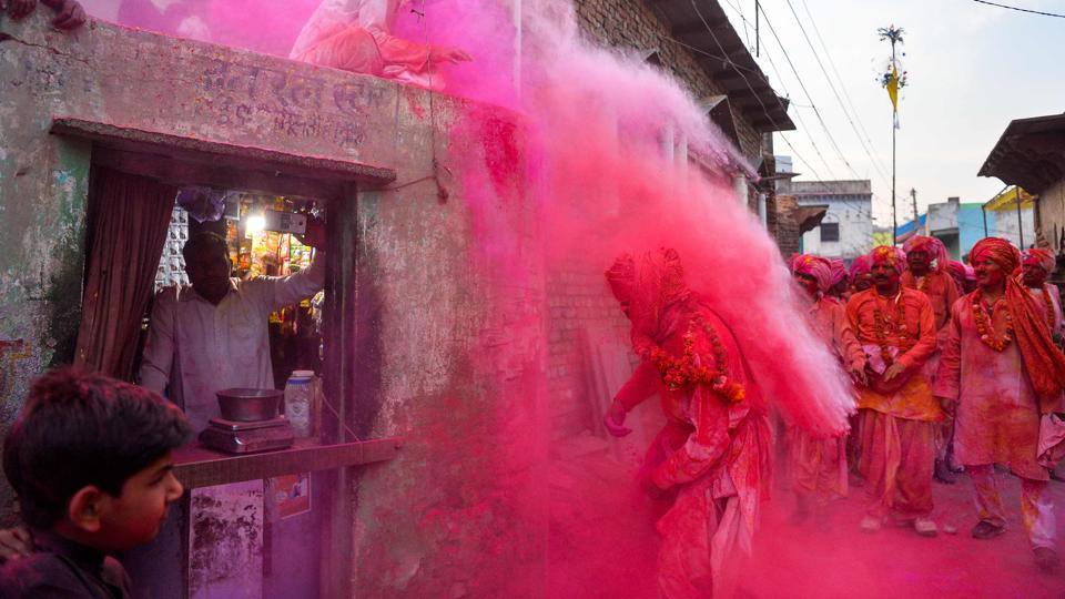 Villagers throw Holi colours during Lathmar Holi celebrations in Mathura, Uttar Pradesh state, on March 14, 2017.