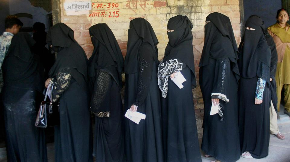 Muslim women line up at a polling booth in Varanasi during the seventh and final phase of the Uttar Pradesh polls on March 8. Despite not having put up a single Muslim candidate, the BJP has now indicated that it would accommodate minority candidates in government.