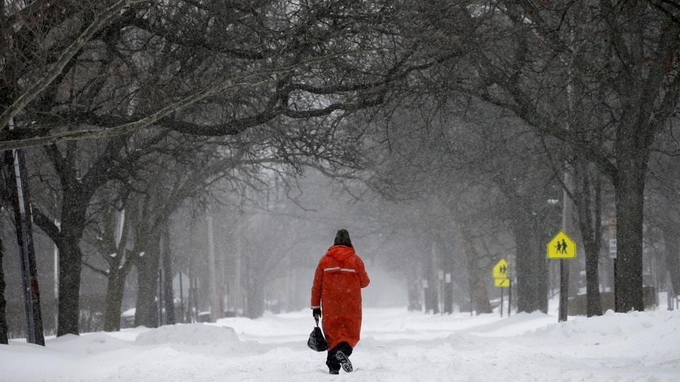A man walks in the centre of a snow covered Broadway during a snowstorm in the village of Nyack, a northern suburb of New York City, U.S. (Mike Segar/REUTERS)