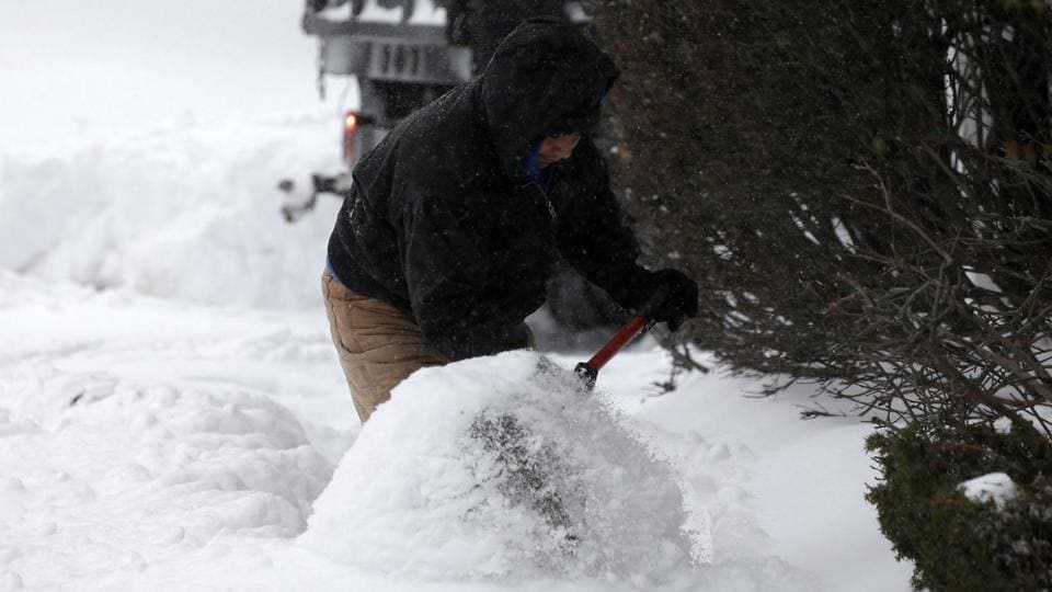 A man shovels snow during a snowstorm in the village of Nyack, a northern suburb of New York City, U.S. (Mike Segar/REUTERS)