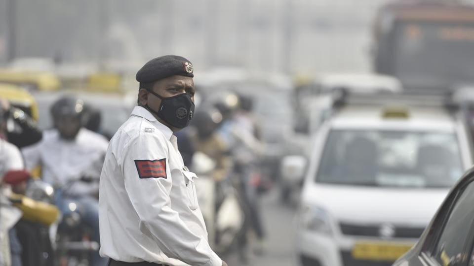 A Delhi traffic cop wears a face mask while managing traffic at ITO  in November 2016. In the days following Diwali, Delhi measured its worst air pollution data as thick smog covered the city.