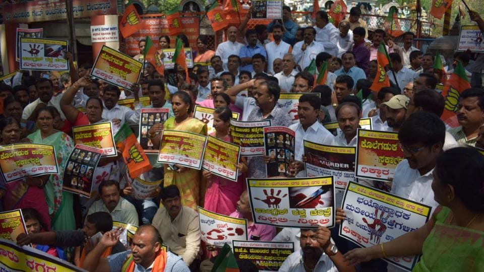 BJP workers take out a protest in Bengaluru on Thursday condemning the murder of a party councillor, Srinivas Prasad.