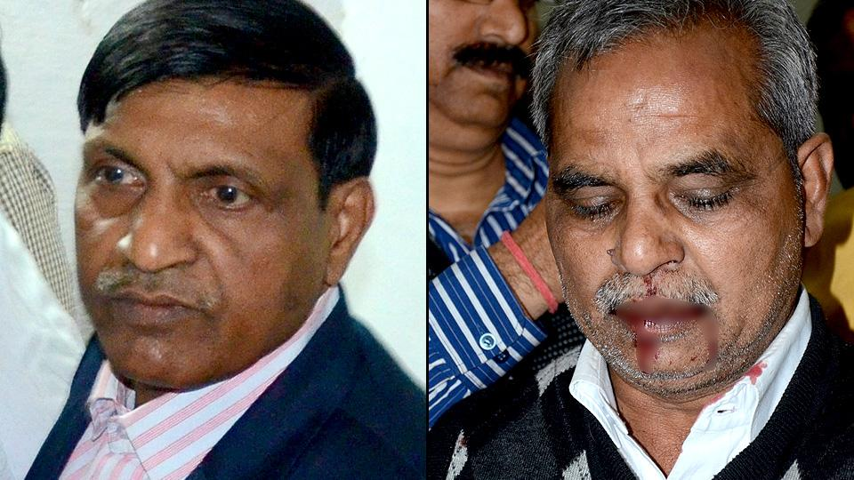 Dr BR Ambedkar University's deputy registrar Sindhi Ram (right) alleged he was abused and assaulted by the registrar KN Singh (left), who has denied the allegations.
