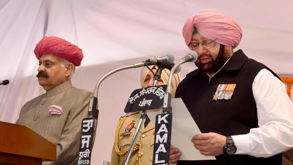 Governor VP Singh Badnore administering oath to the new Punjab chief minister, Capt Amarinder Singh, at Raj Bhawan in Chandigarh on Thursday.