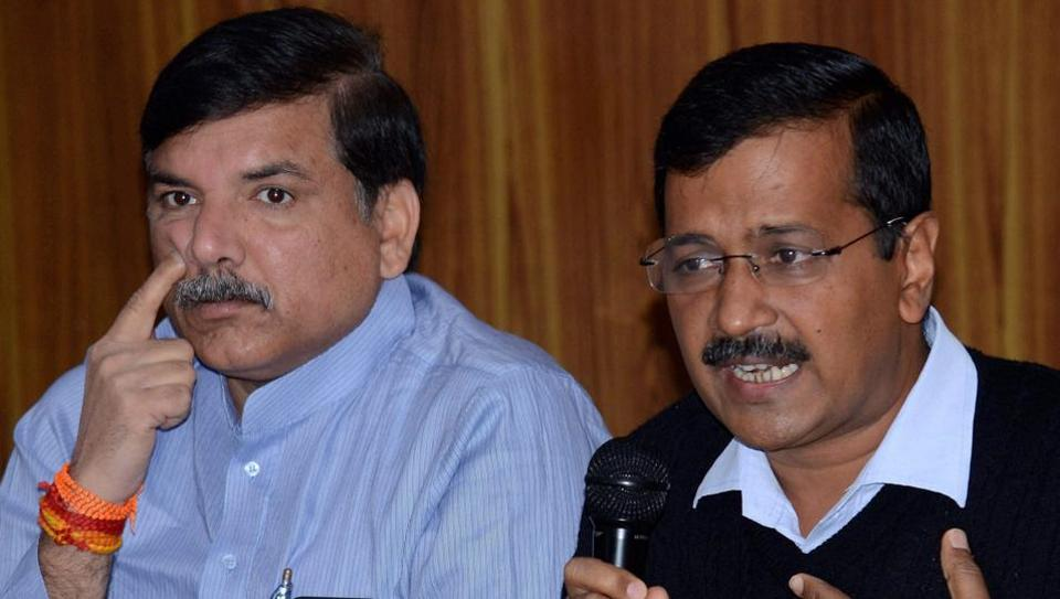 Delhi chief minister Arvind Kejriwal with party leader Sanjay Singh addressing a press conference at his residence in New Delhi.