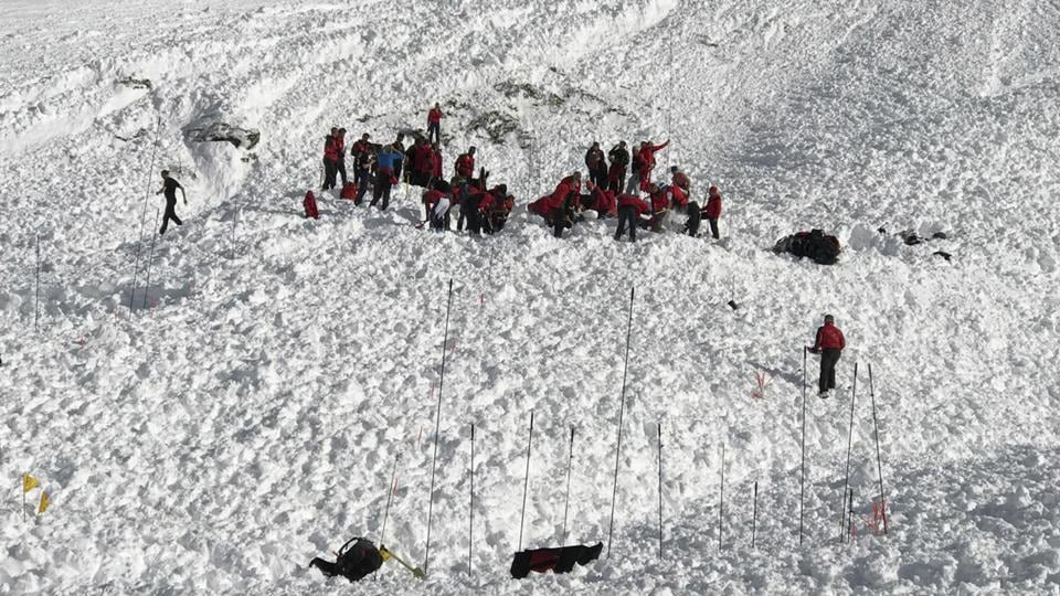 Rescue personnel try to locate a man still missing as they work at the Jochgrubenkopf mountain, southeast of Innsbruck, Austria, Wednesday, March 15, 2017 after an avalanche killed at least three mountain climbers.