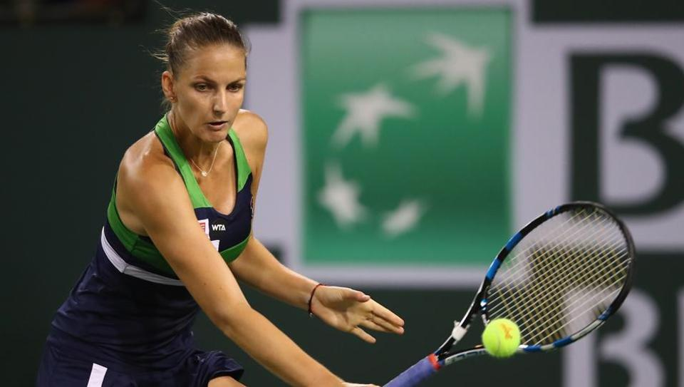 Karolina Pliskova plays a backhand against Garbine Muguruza in their Indian Wells quarter final.