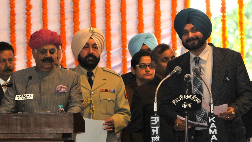 Navjot Singh Sidhu taking oath at Punjab Raj Bhawan in Chandigarh on Thursday.