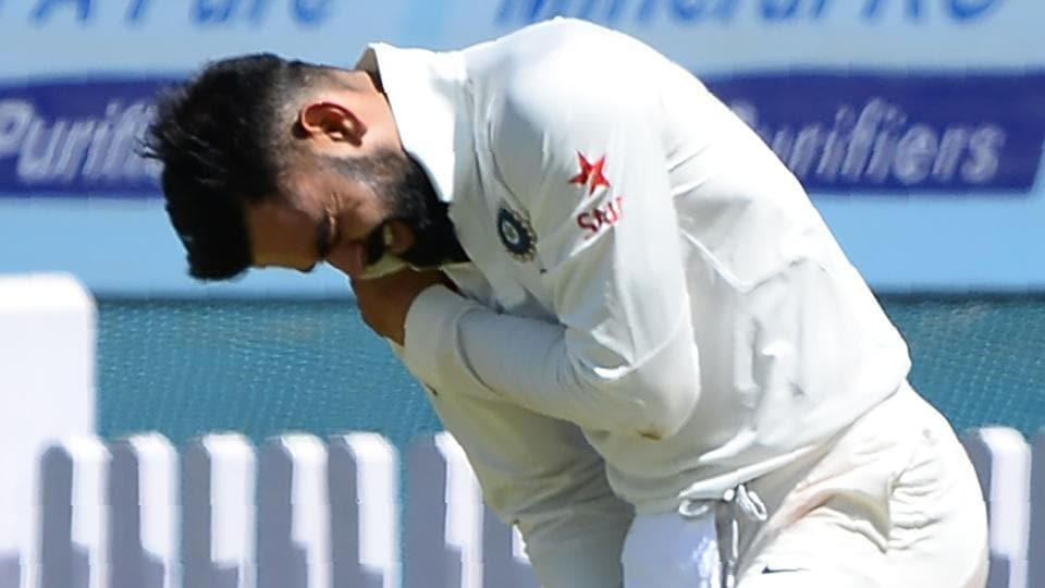 Virat Kohli holds his shoulder in pain after getting injured while fielding during the first day of the third Test against Australia cricket team in Ranchi on Thursday.