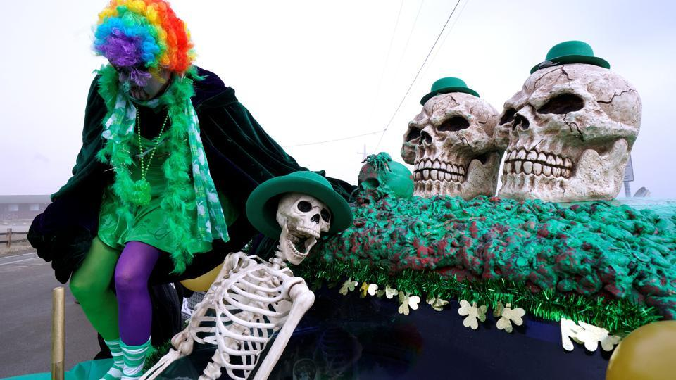 A woman climbs off the roof of a decorated hearse at the annual 'Frozen Dead Guy Days' festival. (Rick Wilking / REUTERS)