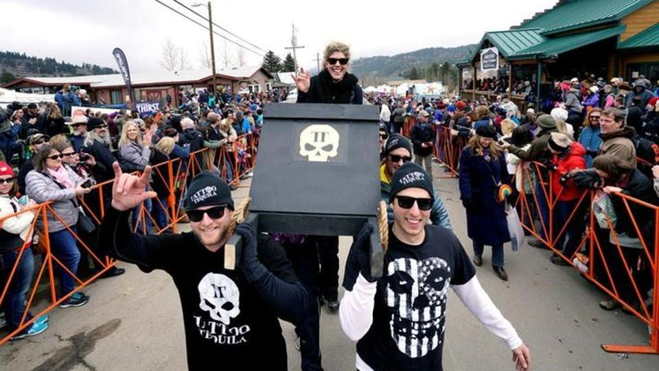 The Tattoo Tequila coffin race team parades down the street  in Nederland.