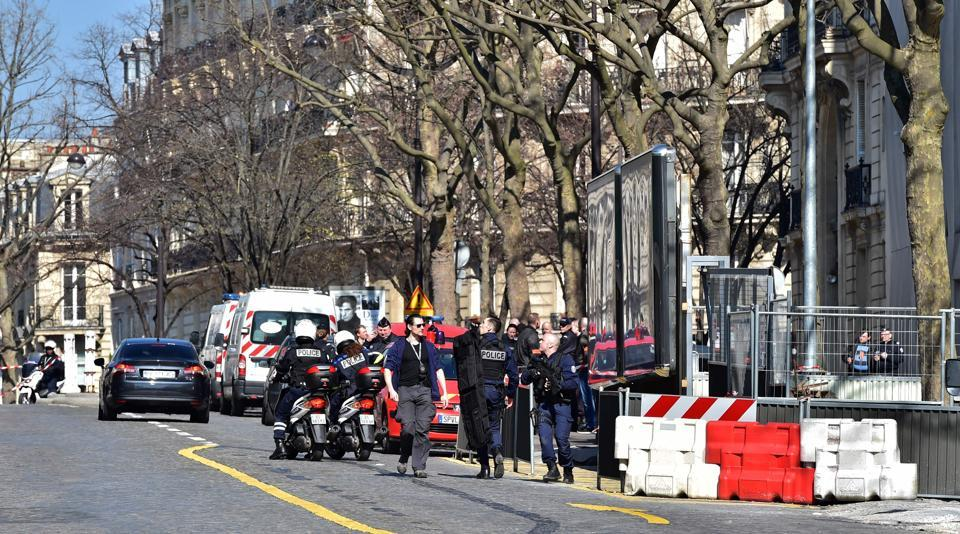 French Police officers secure the scene near the Paris offices of the International Monetary Fund (IMF) on March 16, 2017, after a letter bomb exploded in the premises.
