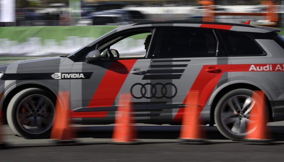 An autonomous car controlled by a Nvidia DRIVE PX 2 AI car computing platform drives passengers along a course during CES International.