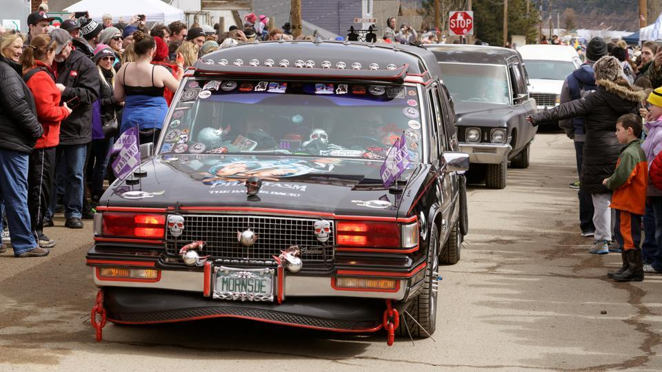 The festival runs for three days, attracts more than 20,000 people a year dressed in skeleton makeup and Halloween costumes, and features musical performances, a frozen salmon toss, a very literal parade of hearses, and a coffin race where teams carry their 'dead' friends to a finish line in a coffin. (Rick Wilking / REUTERS)