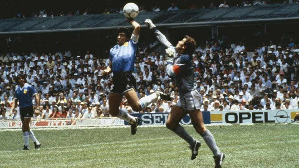 During the 1986 FIFA World Cup quarterfinal in Mexico, Argentina's Diego Maradona scores the first goal with his Hand of God, past England goalkeeper Peter Shilton. Argentina beat England 2-1.