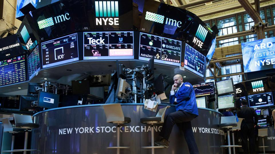 A trader works at his desk on the floor of the New York Stock Exchange (NYSE).