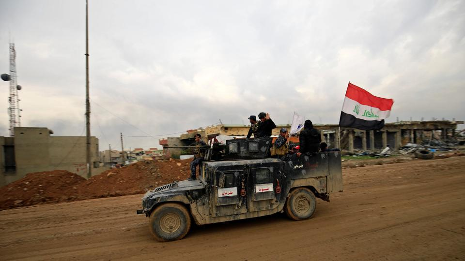 Members of the Counter Terrorism Service (CTS) sit in a military vehicle during a battle between Iraqi forces and Islamic State militants, in the city of Mosul, Iraq March 15, 2017.