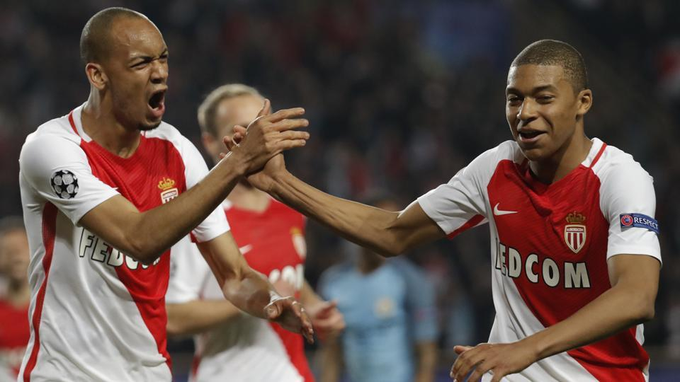 Monaco's Fabinho celebrates with Kylian Mbappe-Lottin after scoring their second goal.