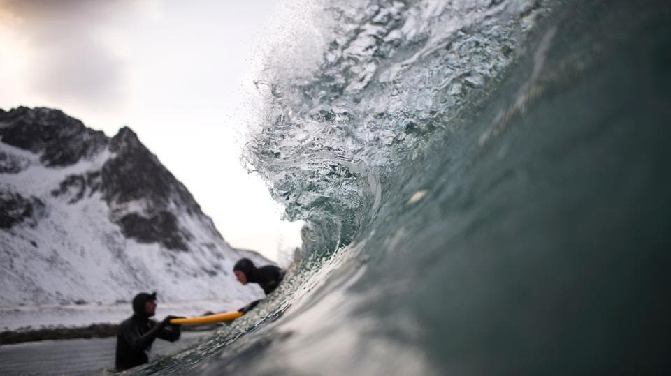 Norwegian surfer Tommy gives a surfing lesson to beginners in Flakstad, near Unstad. (Olivier Morin/AFP)