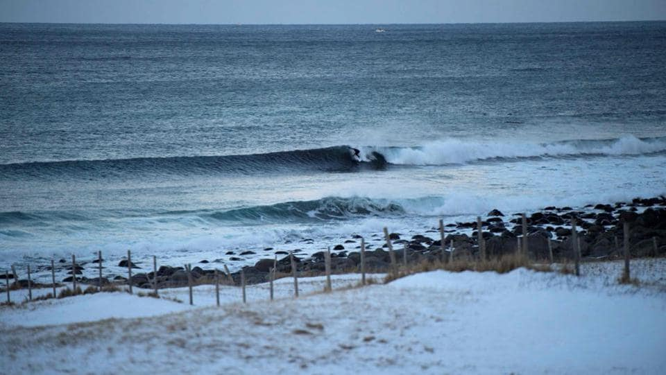 A surfer rides a wave at Unstad along the northern Atlantic Ocean. (Olivier Morin/AFP)