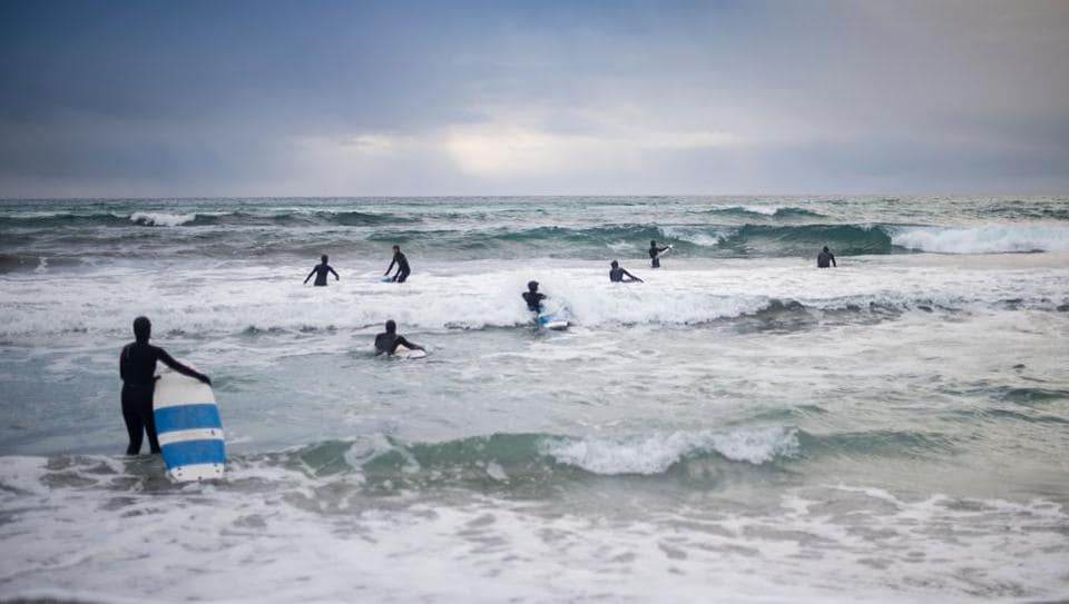 Novice surfers learn how to ride a wave in Unstad along the northern Atlantic Ocean, where the water temperatures is at five degrees centigrade and the air temperature is at minus two degrees centigrade. Unstad, the world's most northern surf school, is perfect for those wanting to try Arctic Surfing.  (Olivier Morin/AFP)