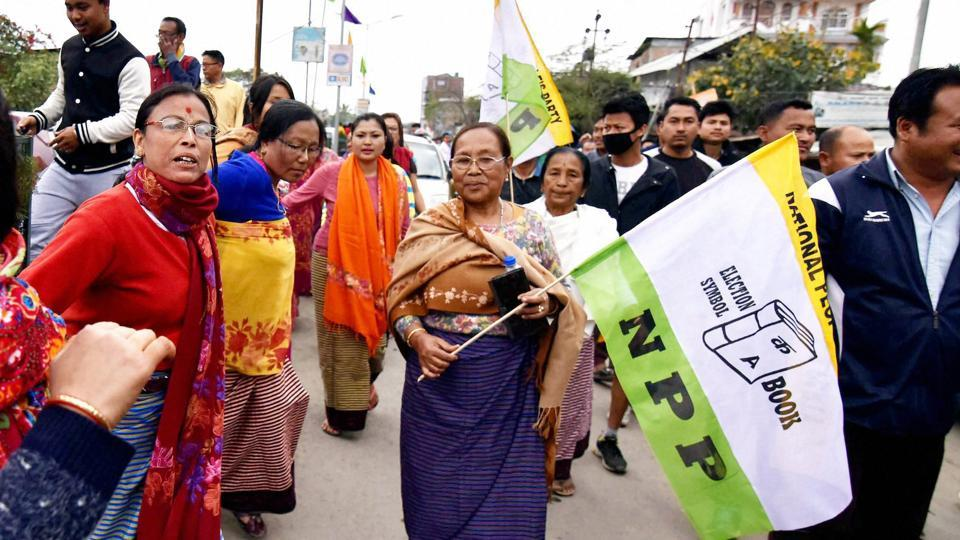 Supporters of the National People's Party (NPP) celebrate after their candidate won in Imphal, Manipur on Saturday.