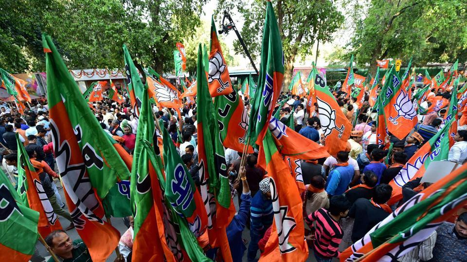 BJP supporters at the party headquarters to celebrate victory in UP and Uttrakhand assembly elections, in New Delhi on Sunday.