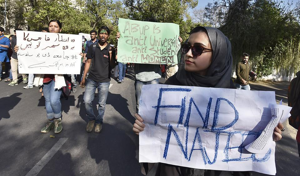 Students hold placards for missing JNU student Najeeb Ahmed. It has been six months since Najeeb went missing from JNU campus.