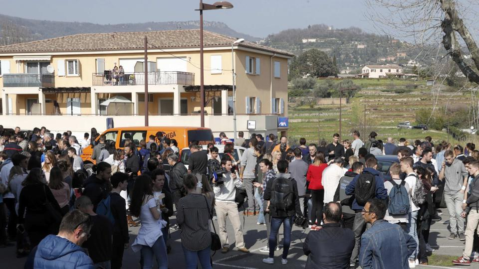 High school students gather near the Tocqueville high school in Grasse in France after a shooting incident.