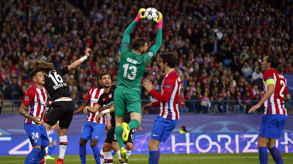 Atletico goalkeeper Jan Oblak makes a save during the Champions League round of 16 second leg against Bayer Leverkusen.