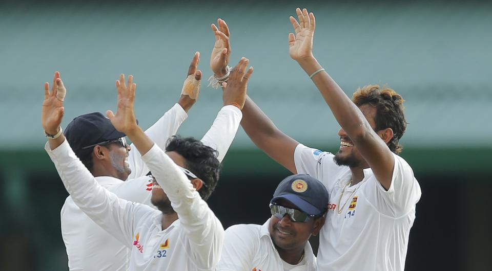 Sri Lanka cricket team's Suranga Lakmal celebrates with skipper Rangana Herath (second right) and other team mates after taking the wicket of Bangladesh national cricket team's Sabbir Rahman in Colombo on Thursday.