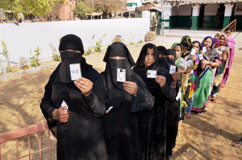 Women line up at a polling station in Mirzapur to cast their votes during the seventh and final phase of the Uttar Pradesh Assembly elections, March 8.  In the recent round of Assembly elections, the pollsters of Lokniti collected field-level data from different parts of Uttar Pradesh, Uttarakhand, Goa, Manipur and Punjab.