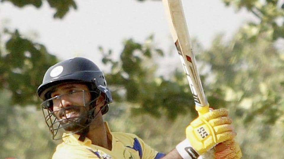 Dinesh Karthik scored 107-ball 77 for Tamil Nadu cricket team, helping his side to a six-wicket win over Baroda cricket team in the Vijaya Hazare Trophy match in New Delhi on Thursday.