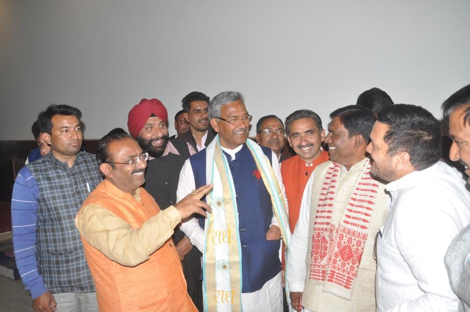 Jubilant Trivendra Singh Rawat with BJP leaders in Dehradun on Friday.  He will be sworn in as the Uttarakhand chief minister on Saturday.