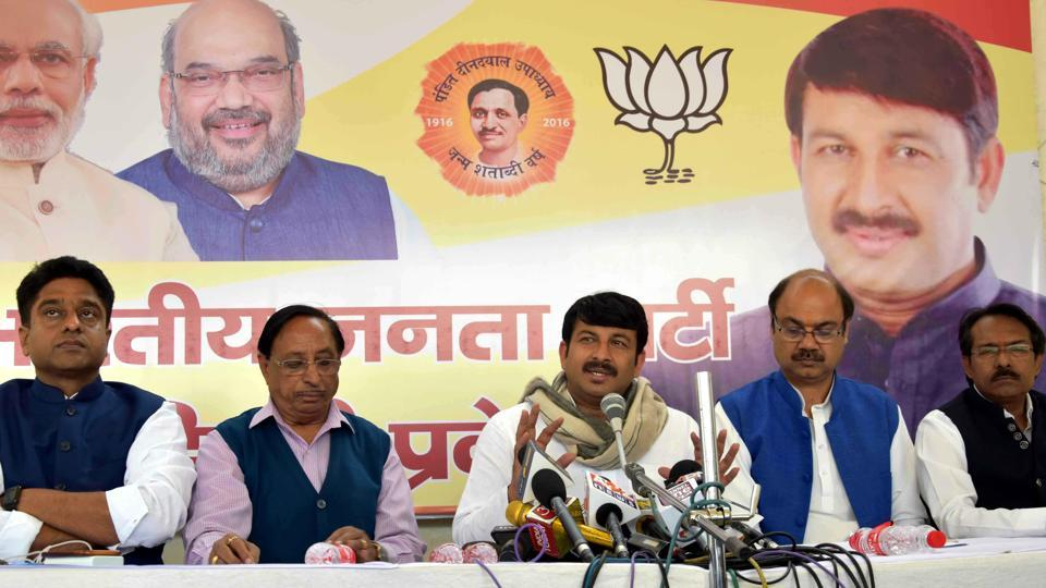 Delhi BJP chief Manoj Tiwari and other party workers at a press conference on Friday.