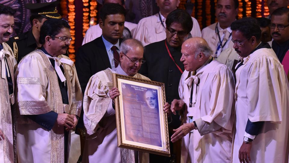 MU chancellor and state governor Ch Vidyasagar Rao (extreme left) and education minister Vinod Tawade (extreme right) look on as President Pranab Mukherjee gives the  degree to Dr MS Swaminathan at Mumbai University on Friday.