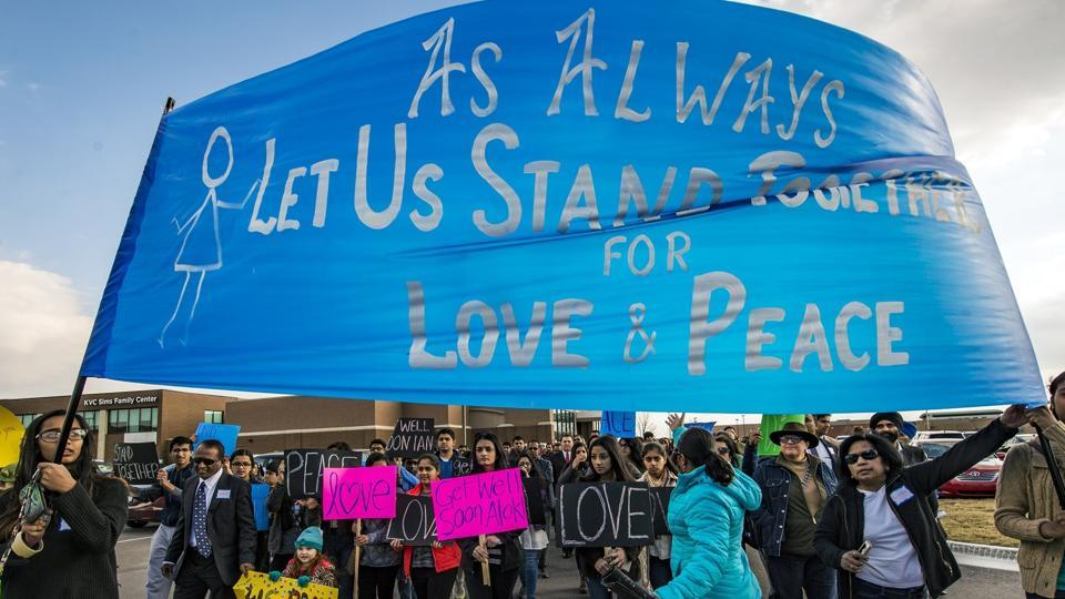 Hundreds of people march for peace on Sunday, Feb. 26, 2017, in Olathe, Kan., before starting a prayer vigil in response to the deadly shooting of two Indian immigrants--Srinivas Kuchibothla and Alok Madasani- and a third man, Ian Grillot, at a bar.