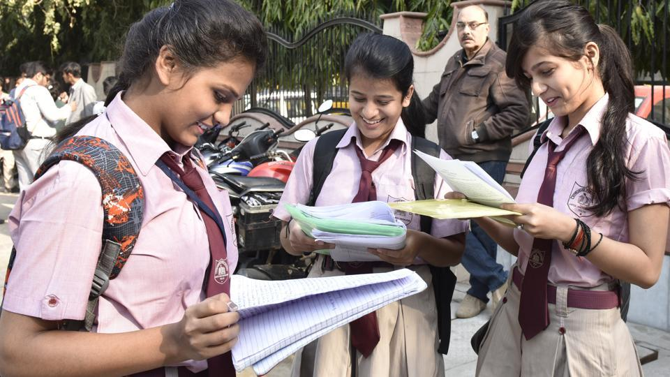 Students outside examination centre before writing their CBSE Class 12 board exam at Evergreen School, Vasundhra Enclave on Thursday.