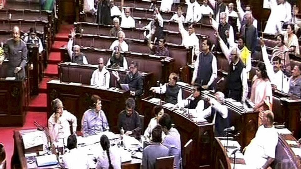 Opposition party members protest in the Rajya Sabha in New Delhi.