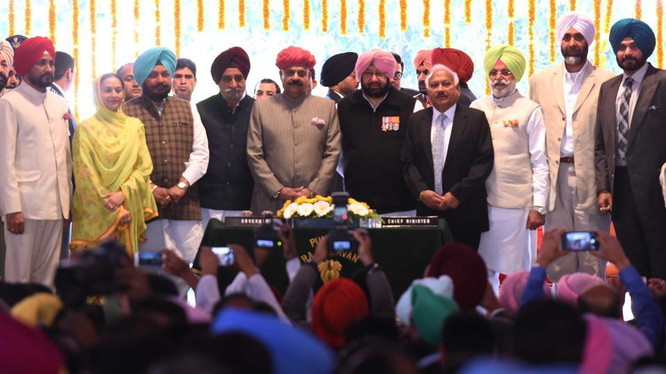 Punjab governor VP Singh Badnore, CM Capt Amarinder Singh with newly inducted ministers (from left) Charanjit Singh Channi, Aruna Chaudhary, Sadhu Singh Dharamsot, Tript Rajinder Singh Bajwa, Brahm Mohindra, Rana Gurjit Singh, Manpreet Singh Badal, Navjot Singh Sidhu and Razia Sultana after the swearing­in at Punjab Raj Bhawan in Chandigarh on Thursday.