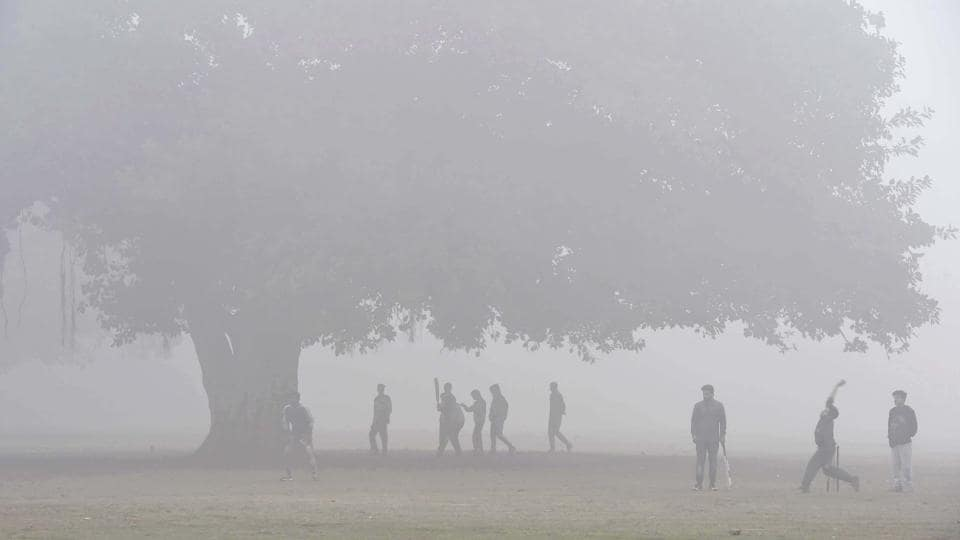 People playing cricket in cold weather near India Gate in New Delhi, in this representative file photo from February.