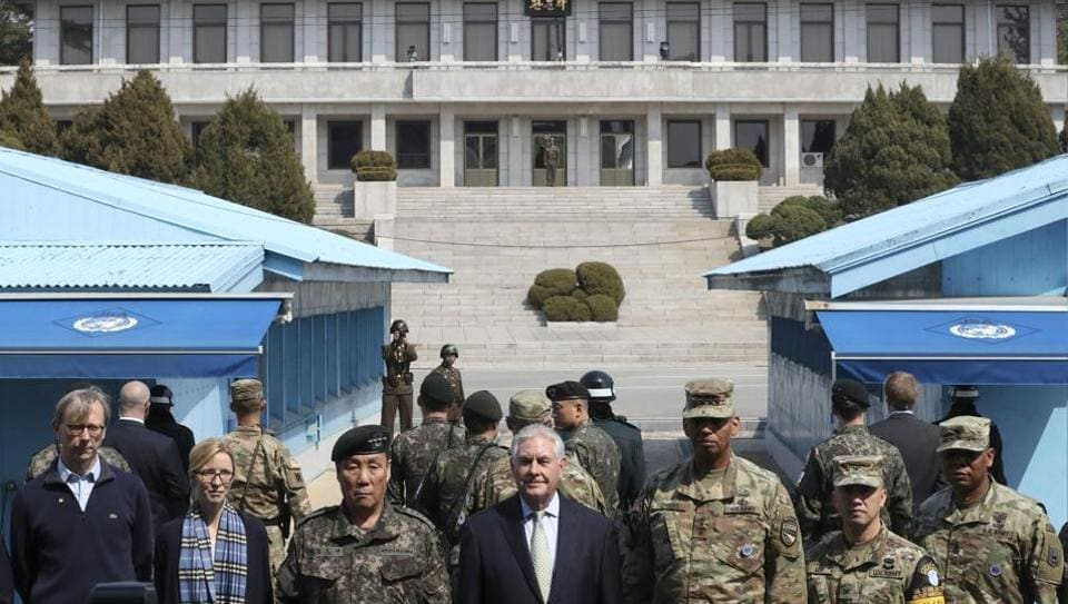 US secretary of state Rex Tillerson (C) stands with US Gen. Vincent K. Brooks (3rdR), commander of the United Nations Command, Combined Forces Command and United States Forces Korea and deputy Commander of the Combined Force Command General Leem Ho-young (3rdL), as North Korean soldiers look at the south side in the border village of Panmunjom, which has separated the two Koreas since the Korean War, South Korea.
