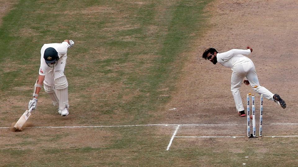 Ravindra Jadeja of India cricket team runs out Australia cricket team's Josh Hazlewood (left) during Day 2 of the third Test in Ranchi on Friday.