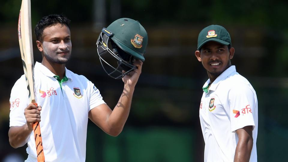 Shakib Al Hasan (left) celebrates his century as teammate Mosaddek Hossain watches on third day of the second and final Test between Sri Lanka and Bangladesh at The P. Sara Oval Cricket Stadium in Colombo on Friday. Catch live cricket score of Sri Lanka vs Bangladesh here.